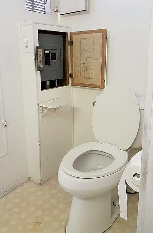 Electrical panel by toilet is illegal